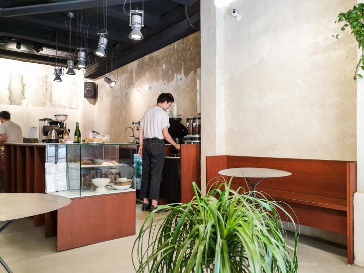 Inside Acid Cafe - minimalistic interior with a lot of greenery.