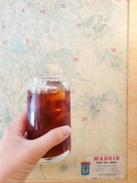 a cup of cold brew with a map of Madrid as a background.