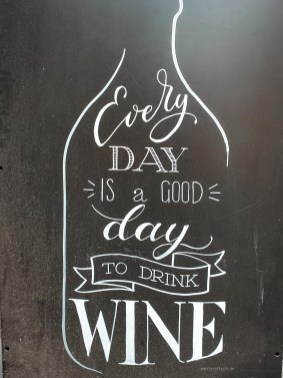 "A blackboard sign that says ""Every day is a good day to drink wine""."