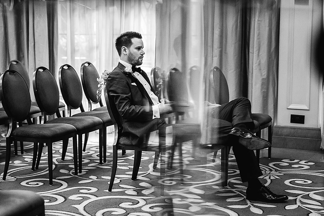 Corinthia Hotel Wedding Photographer groom in quiet reflection in a reflection