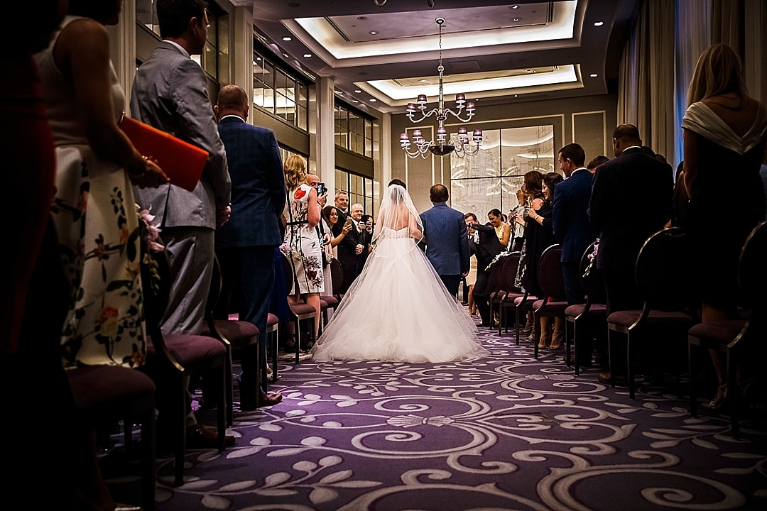 Corinthia Hotel Wedding Photographer bride and father walking up the aisle