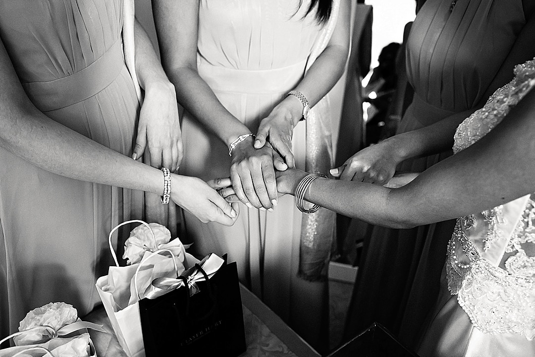 vill Court Wedding Photography Bride and Bridesmaid holding hands