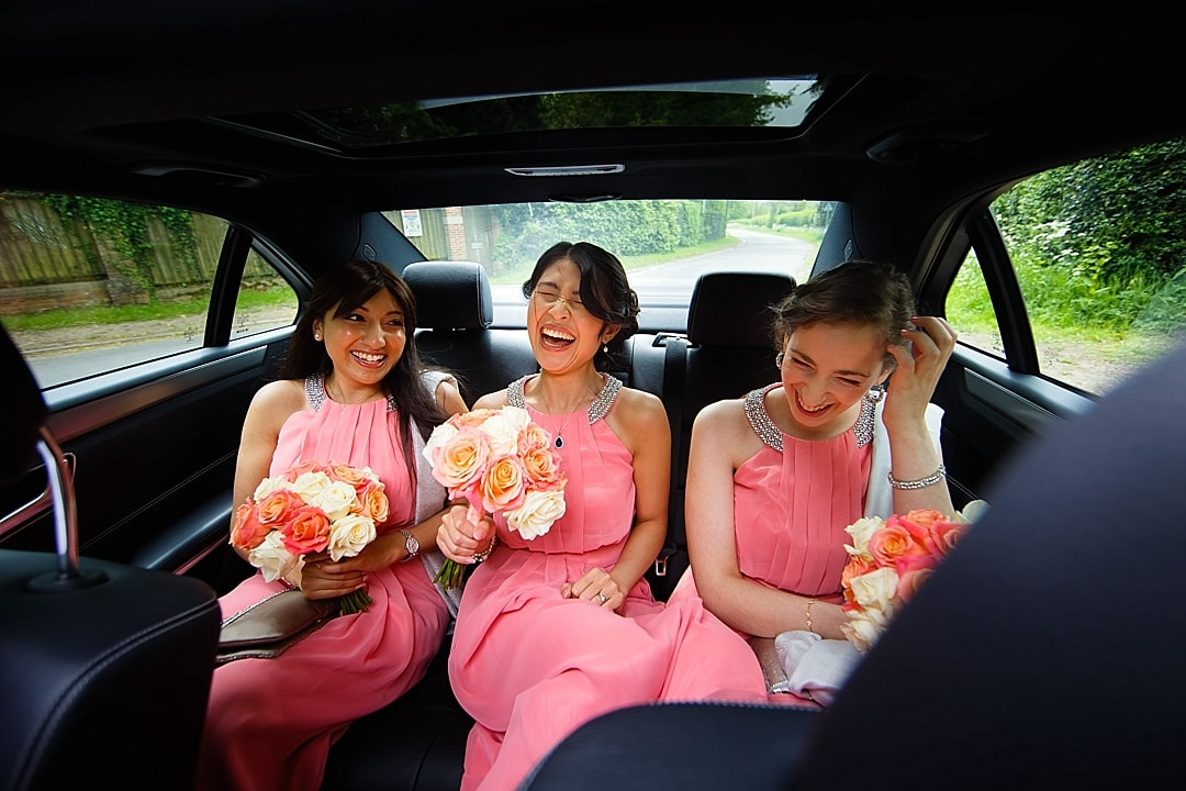 vill Court Wedding Photography Bridesmaids travelling to the church