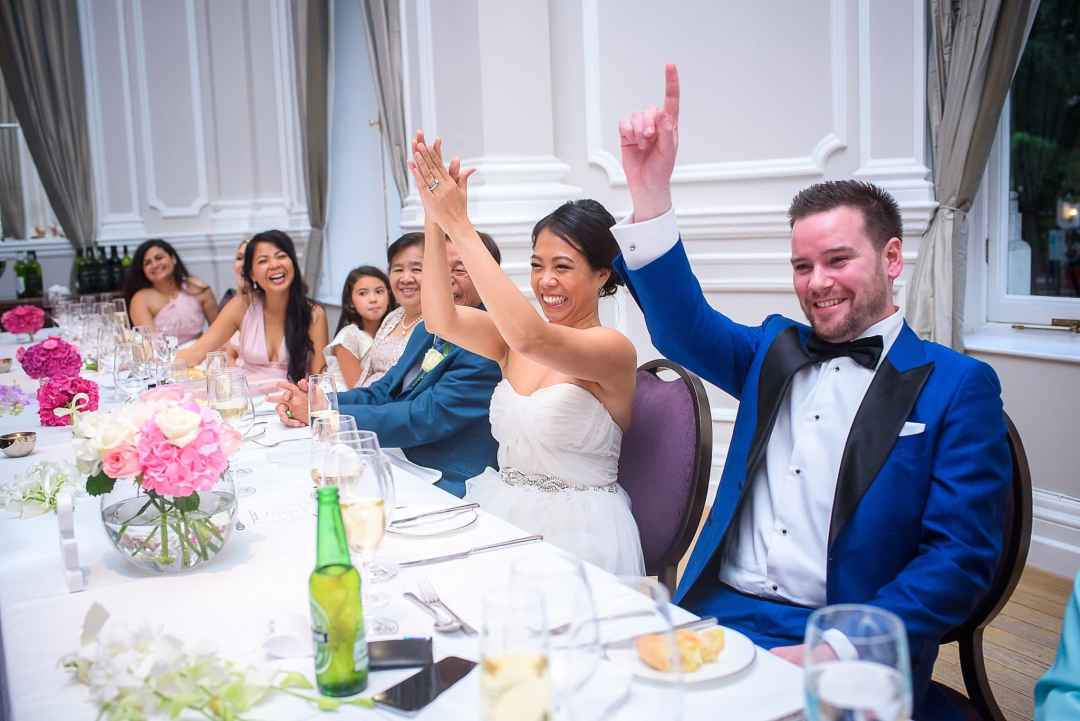 Corinthia Hotel Wedding Photographer Bride and Groom clapping