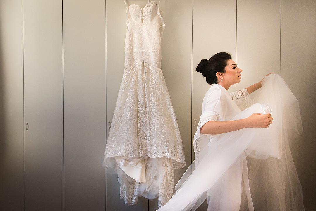Bride carrying dress at Lake Como