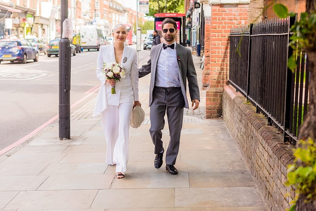 Islington Town Hall Wedding Photographer Bride & Groom arriving for the ceremony