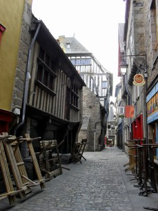 Early Morning in Dinan, a charming street waits in readiness to be transformed in to a bustling restaurant strip in spring.