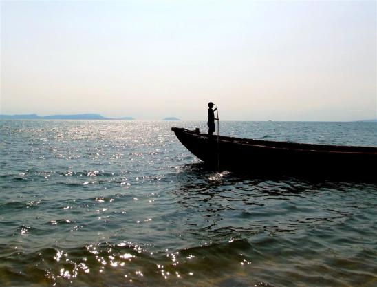 The boatman waits patiently for the return journey