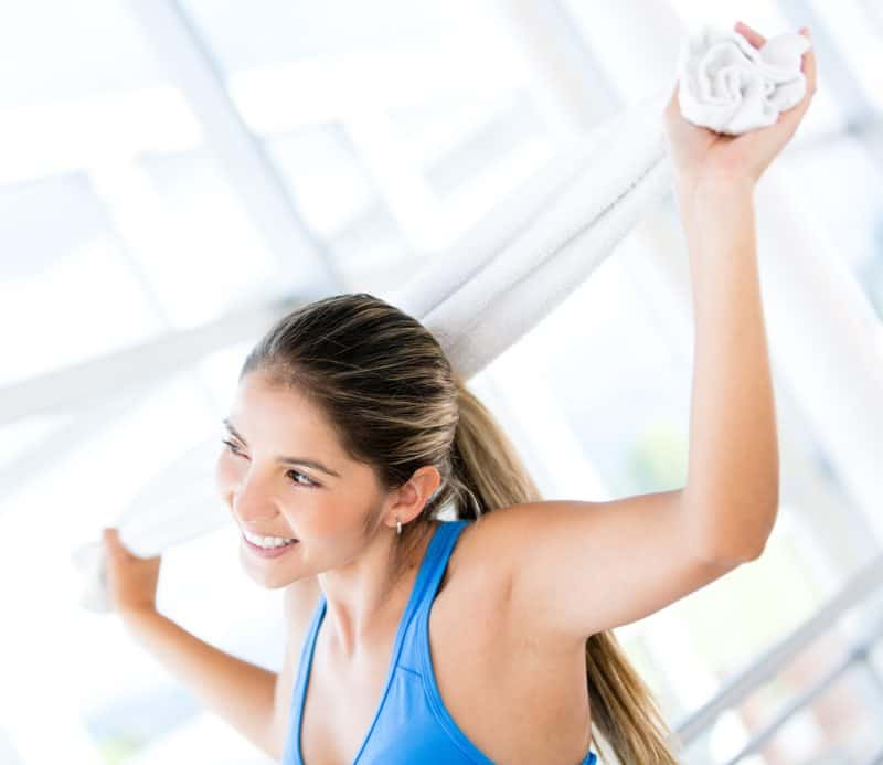 Happy woman at the gym after a good workout