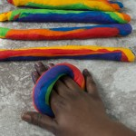 09-overlap-the-rope-and-press-down-with-your-palm-around-your-hand-to-make-the-bagel-shape,-wear-gloves-when-incorporating-the-colours-so-your-hands-don't-end-up-like-mine-#rainbowbagels