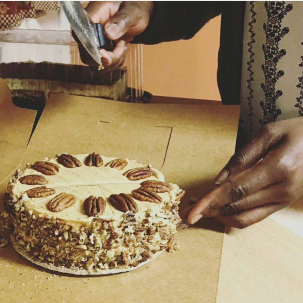 brown-sugar-ackee-cake-being-sliced-for-the-dinner-party