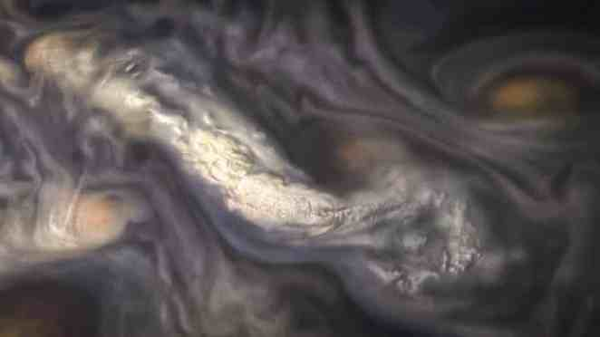 High-Altitude Jovian Clouds formation surrounded by swirling patterns in the atmosphere