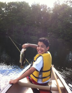 A picture is worth a 1000 words... Christian's first ever largemouth bass caught on a soft stickbait
