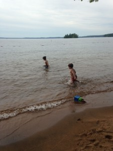 Splashing in the water at one of the beaches at Sebago Lake State Park