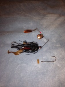 This spinnerbait has two small Colorado blades and a second hook attached to the in-line hook to deal with short strikes.