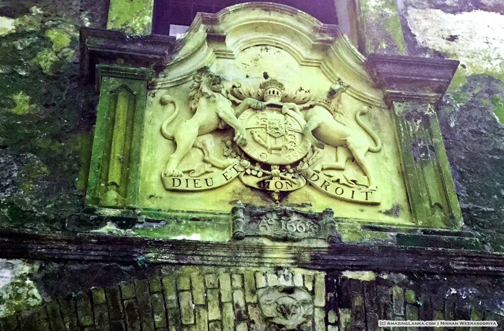 Coat of Arms of Great Britain above the Dutch VOC insignia at the top of the old entrance of the Galle Fort dated 1668 seen from outside the fort