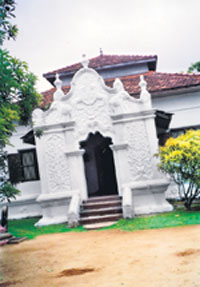 The pilimage, lying in the Vihara premises; on the gable overhead are figures of two elephants and two lions embossed on it.