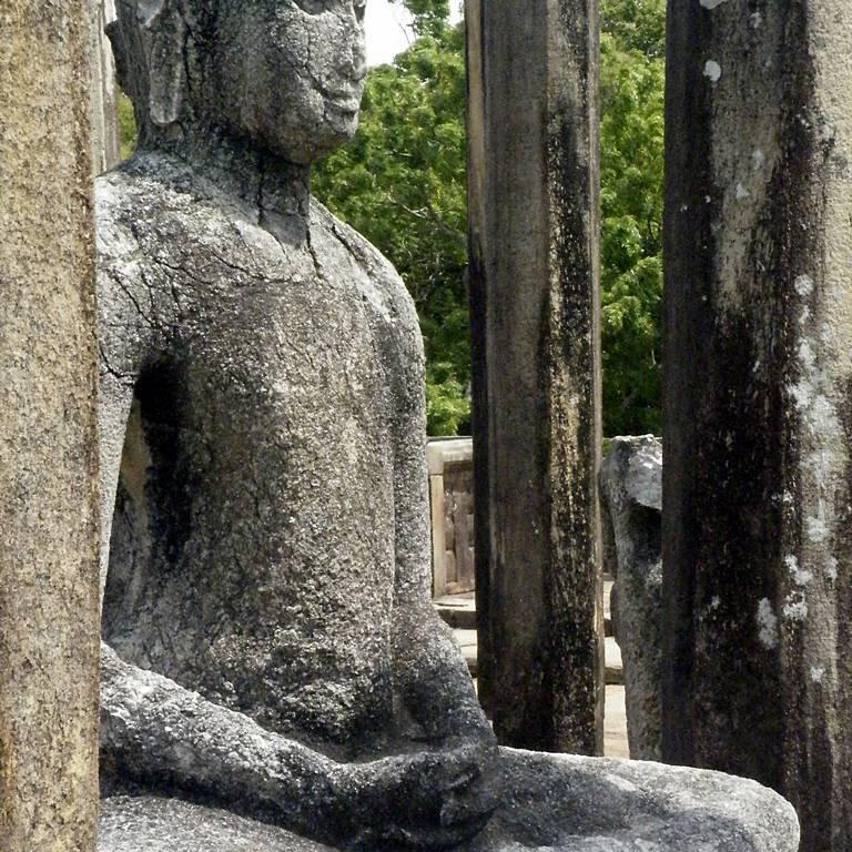 Serene Buddha Statues on the four corners of the Medirigiriya Vatadage