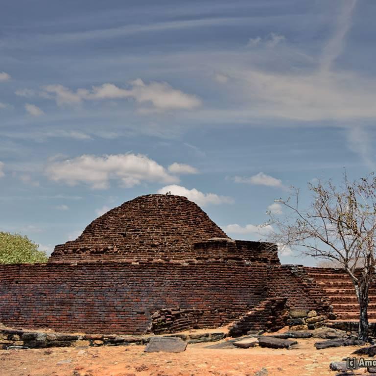 The resotored stupa on a rock at Medirigiriya Vatadage site