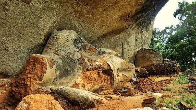 Reclining Buddha statue destroyed by treasure hunters at the Bambaragasthalawa Caves inside Kumana