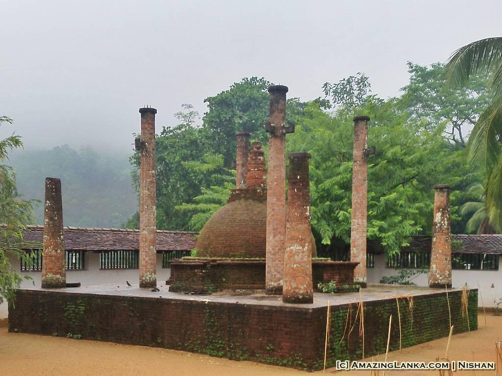 ancient stupa with brick columns surrounding it