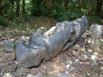 A standing Buddha statue damaged and broken at archaeological site at Parakramapura - Padaviya