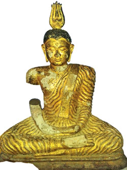 Recovered gold plated Buddha statue with part of the arm missing at Kotasara Piyangala Rajamaha Viharaya