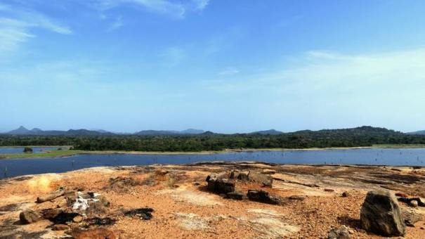 Remains of the past on the rocks at the Kanchikudichchi Aru Reservoir