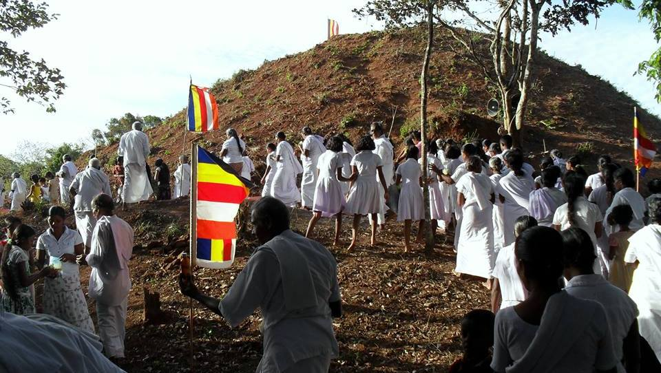 A shramadana by the villagers to clean the larger stupa at the top of the mountain - Upulwehera Archaeological Site