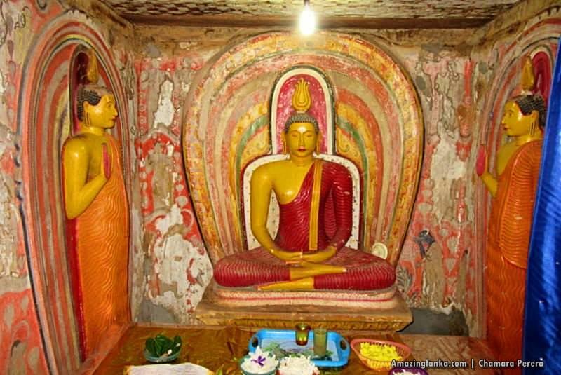 The main Buddha statue inside the Tampita Viharaya at Atupothdeniya Pothgul Rajamaha Viharaya