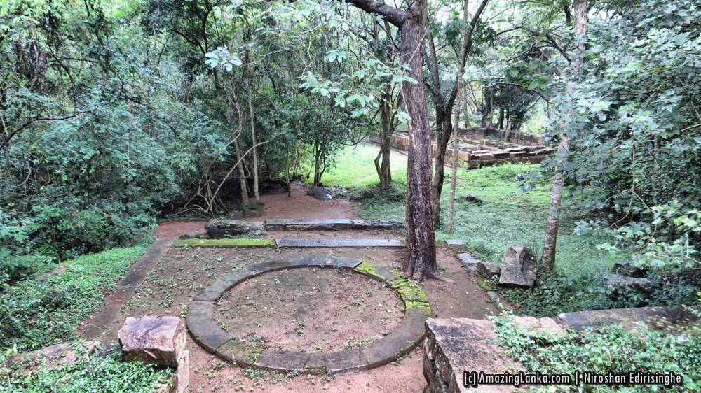 View of Ritigala A circular platform built from stone on the winding path beneath the forest canopy at Manakanda ancient monastery