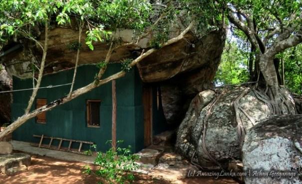 ancient dripledge caves converted to Kuti for the meditating bikkus - Kahatagollewa Gal Piyuma Monastery
