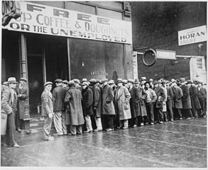 Unemployed men queued outside a depression soup kitchen opened in Chicago by Al Capone, 1931