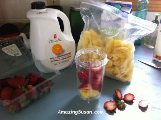 Pineapple and strawberries in the Bullet cup waiting for the other ingredients...