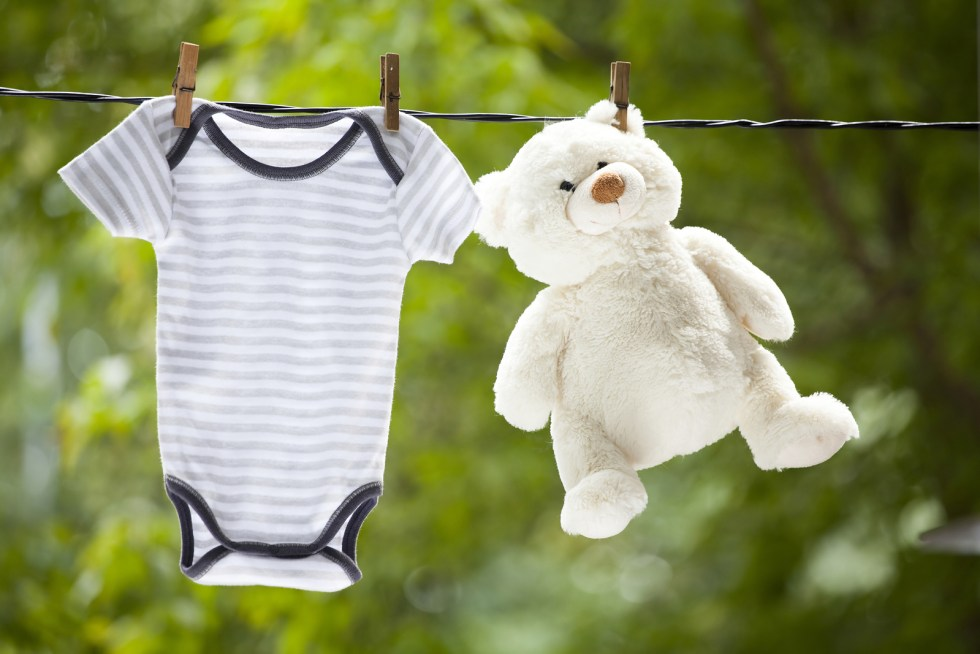 Baby boy clothes hanging on the clothesline.