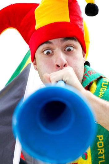 soccer fan blowing vuvuzela
