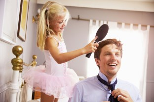 Daughter Helps Father To Get Ready For Work By Brushing Hair