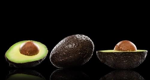 "fresh ""ready to eat"" avocado on black background"