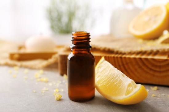 Beautiful spa composition with lemon essential oil on table, clo