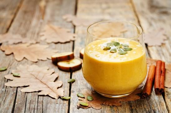 Pumpkin Banana smoothies on a dark wooden background.
