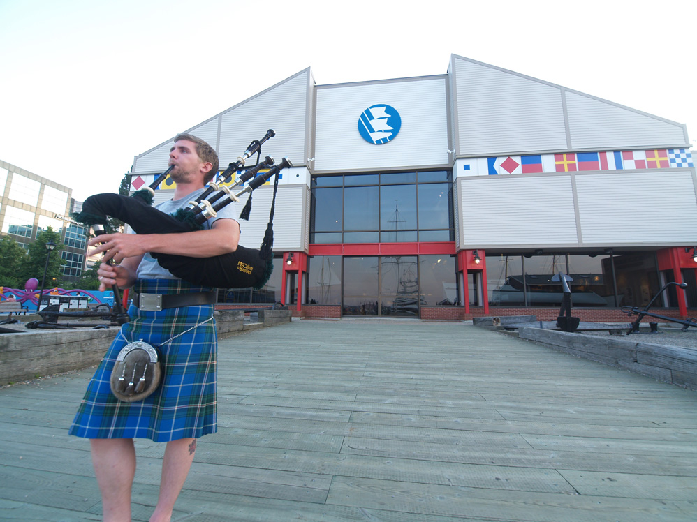 A piper performing on his bagpipes.