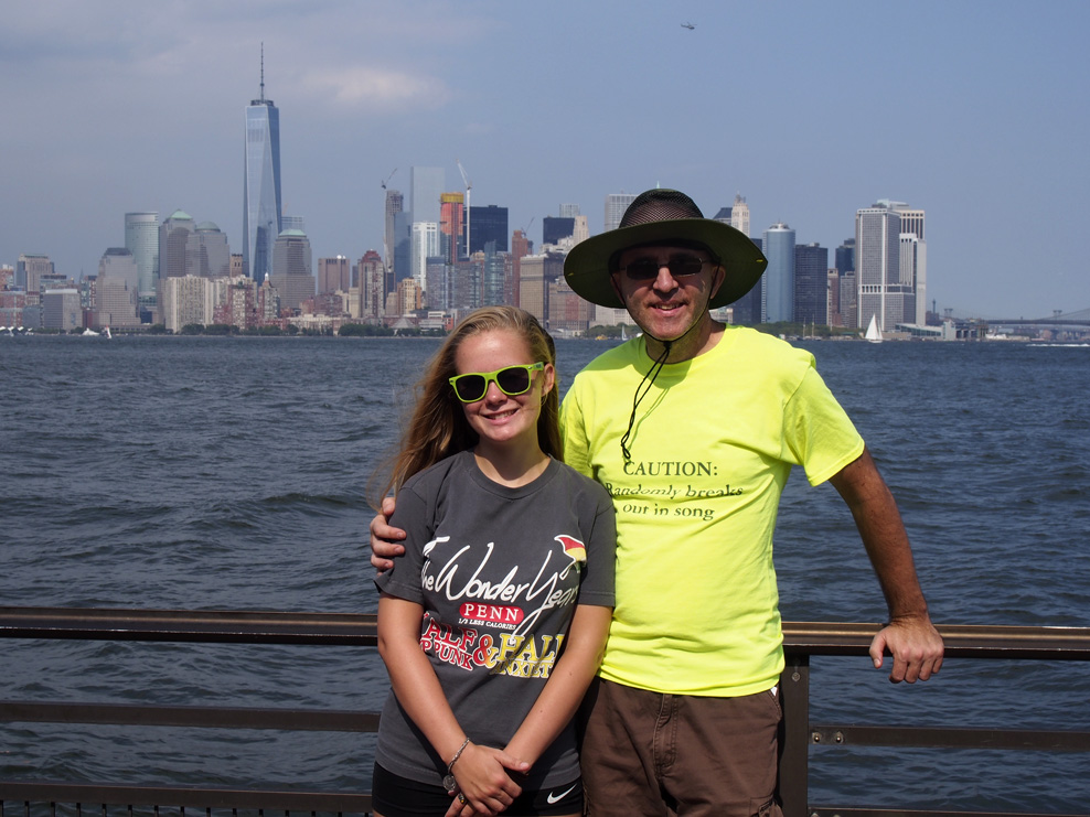 Me and my daughter in front of the New York City skyline.