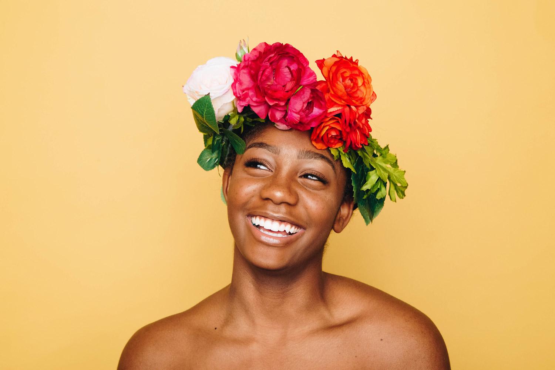 Happy woman with flowers on head confidence self-esteem