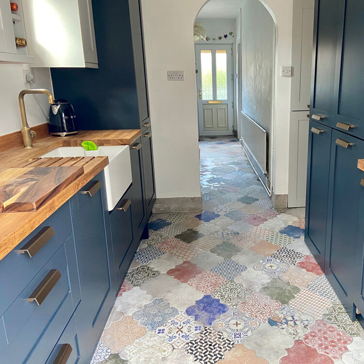 spanish tiles and bright blue cabinets