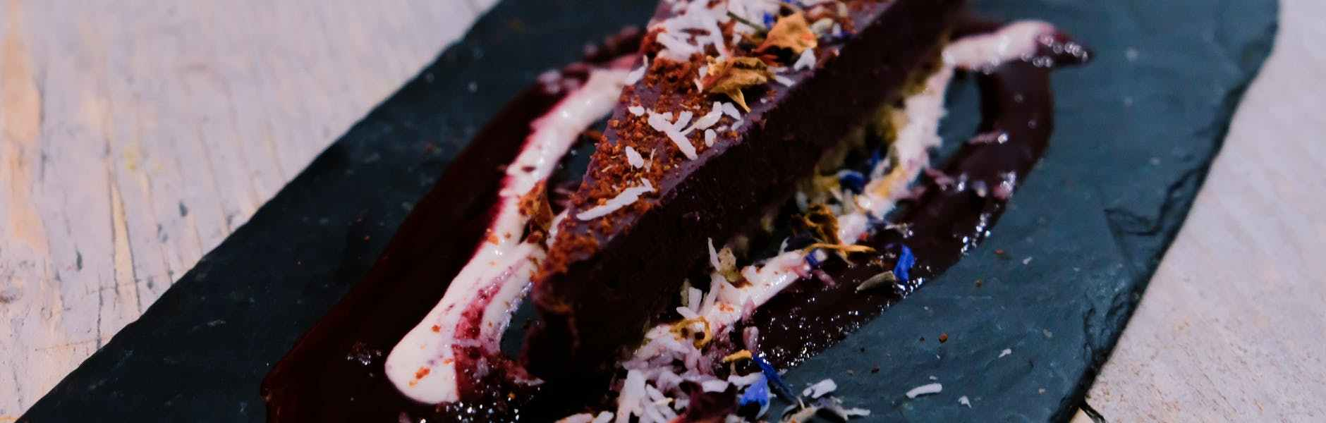 piece of tasty chocolate cheesecake with coconut flakes in cafe