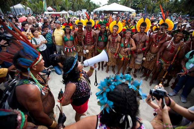 Sonia Bone Guajajara, VP of the Coordination of the Indigenous Organizations of the Brazilian Amazon (COAIB), addresses indigenous marchers on Rio's Flamengo Beach on June 19, 2012.