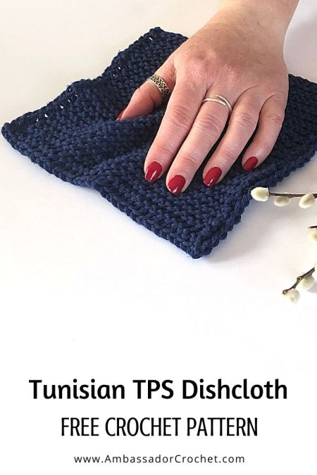 navy blue dishcloth made with the Tunisian purl stitch.