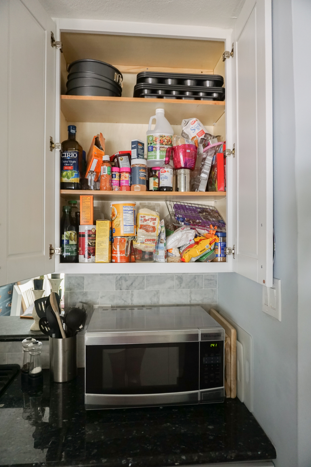 An Unorganized Baking Cabinet   Organizing Baking Supplies Is Easy With  Cork Tiles, Command Hooks