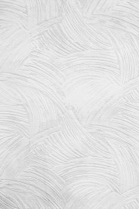 Repeating pattern of swirls in white paint.