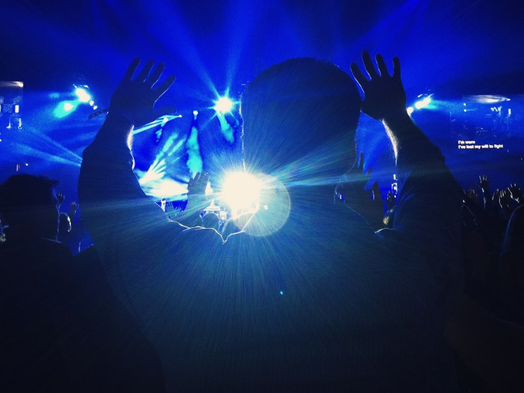 Photo of person cheering by Melissa Askew